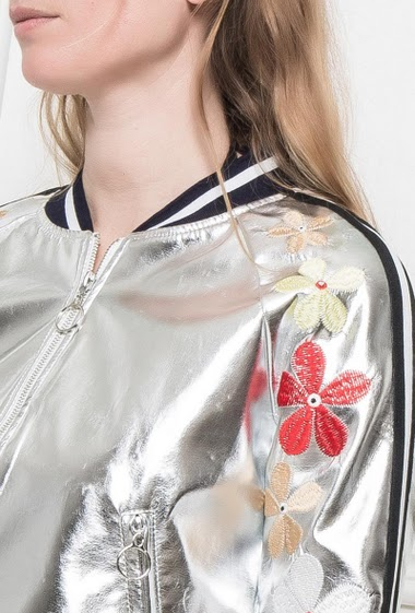 Shiny jacket, sleeves decorated with embroidered flowers, zipped pockets, casual fit