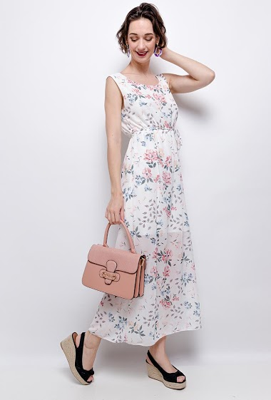 Dress with ruffles, printed flowers. The model measures 178 cm
