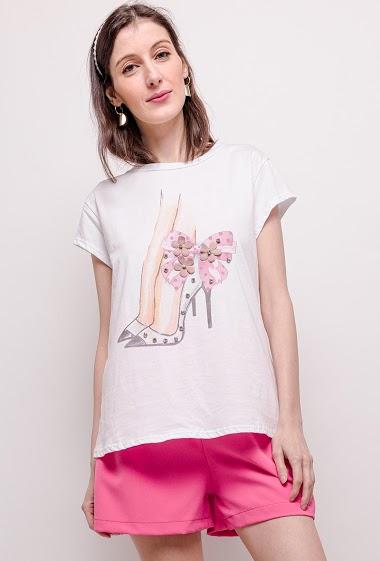 T-shirt à message imprimé. La mannequin mesure 177cm, TU correspond à 38/40. Longueur:63cm