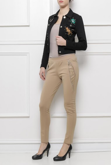 Pants with elastic waist, zip and eyelets on the side, skinny fit