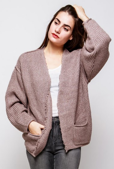 Loose cardigan, open front, ribbed knit, pockets. The model measures 172cm, one size corresponds to 38-42