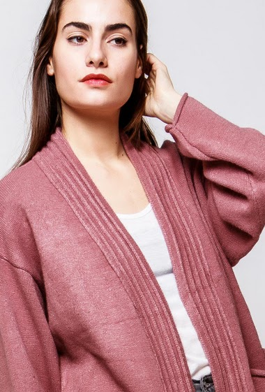 Long cardigan with pockets, ribbed border, loose fit. The model measures 172cm, one size corresponds to 38-42
