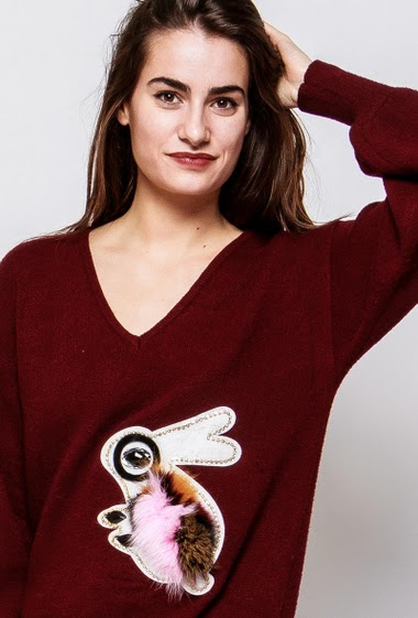 Long sweater, rabbit in fur, diamonds, puffed sleeves, casual fit. The model measures 172cm and wears S/M