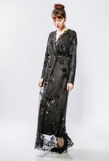 Dress with embroidered sequins, cross V neck, elastic waist, long sleeves. The model measures 174cm and wears S