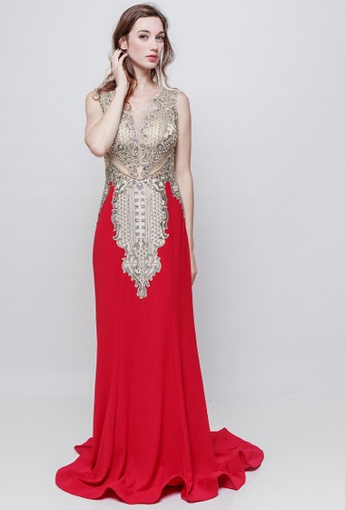 Sleeveless dress decorated with strass, transparent back, padded chest, zip closure The model measures 177 cm and wears S