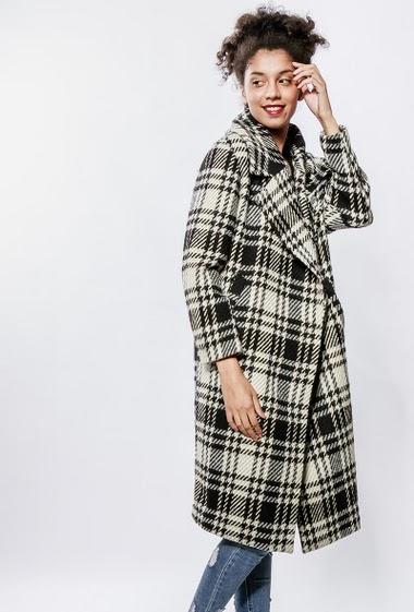 Manteau en laine mélangée, carreaux bicolores. La mannequin mesure 176cm et porte du S/36