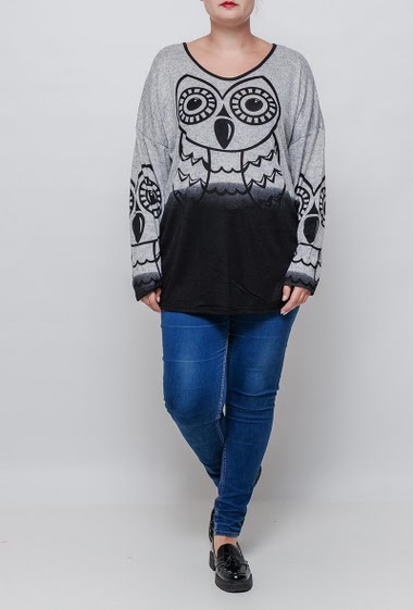 Tunic sweater with printed owl. The model measures 171cm and wears T3=44/46. T4=48/50 and T5=52-54