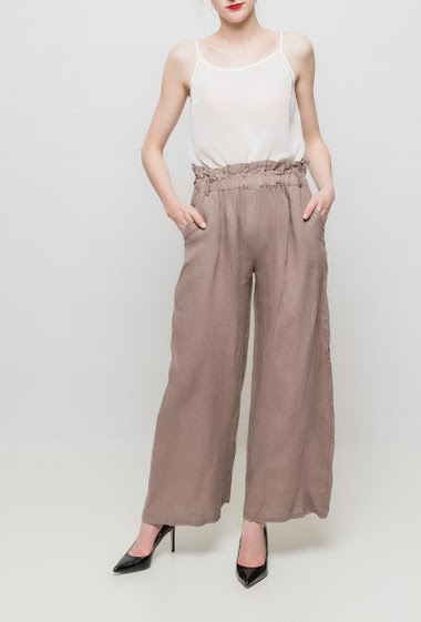 Flared pants, elastic waist, pockets. TU corresponds to T38/40