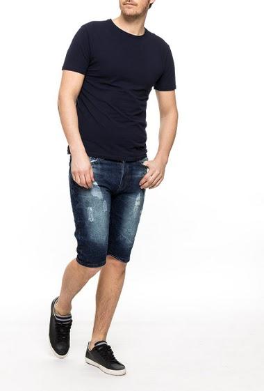 Short en jean délavé et déchiré