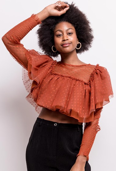 Frill blouse in spotted tulle. The model measures 174cm and wears S. Length:40cm