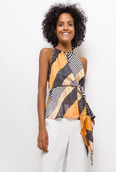 Printed sleeveless top. The model measures 177cm and wears S. Length:60cm