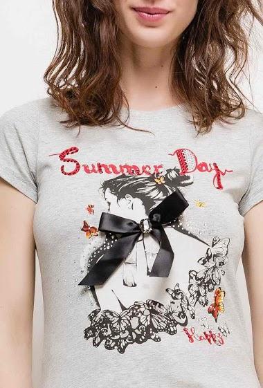 T-shirt à manches courtes. La mannequin mesure 177cm et porte du S. Longueur:60cm