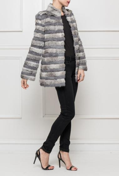 Coat in striped fur, closure with hooks