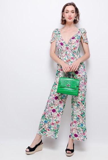 Printed wrap jumpsuit, ruffles, pockets, elastic waist. The model measures 177cm and wears S. Length:130cm