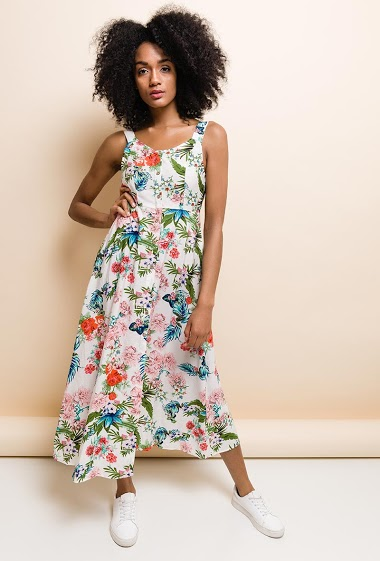 Flowers printed dress round neck, sleeveless, elastic waist. Open back to tie. 2 side pockets. The model measures 177cm and wears M. Length:125cm