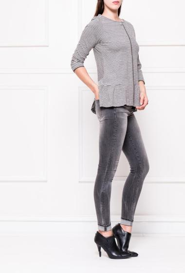 Striped and draped top with a three-quarter length sleeves.