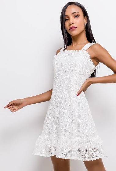 Feminine sleeveless dress. The model measures 170cm and wears S. Length:86cm