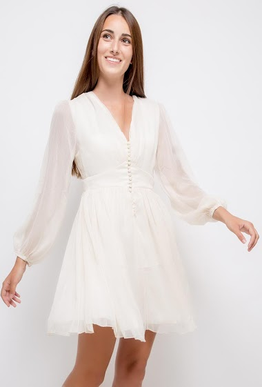 Feminine dress, transparent long sleeves. The model measures 178cm and wears S. Length:90cm