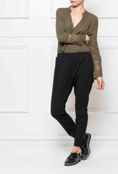 Wrap jumpsuit with elastic waist, sleeves decorated with lace