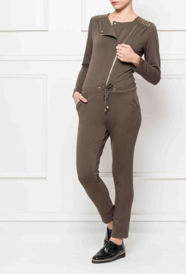 Fleece jumpsuit with zip on the front, shoulders decorated with strass, drawstrings and pockets