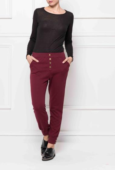 Fleece joggings with buttons, elastic waist and tightened ankles