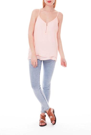 Double layered sleeveless top with zip front
