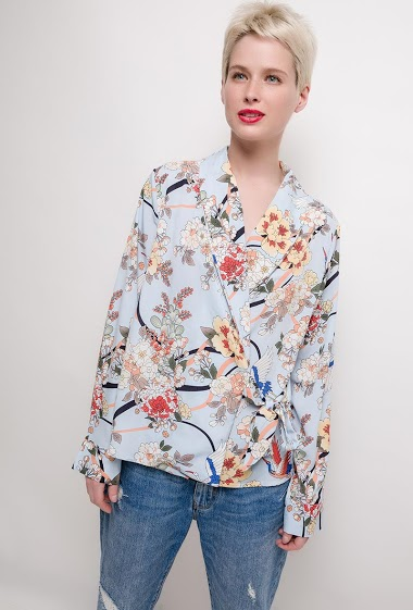 Blouse with printed flowers, long sleeves. The model measures 172cm and wears M. Length:65cm