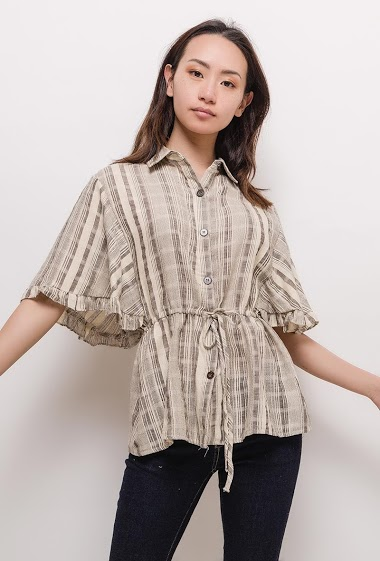 Blouse with ruffles, drawstring. The model measures 170cm and wears M. Length:65cm