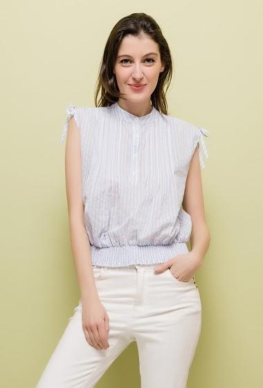 Sleeveless top, elastic waist, smocks. The model measures 178cm and wears M. Length:55cm