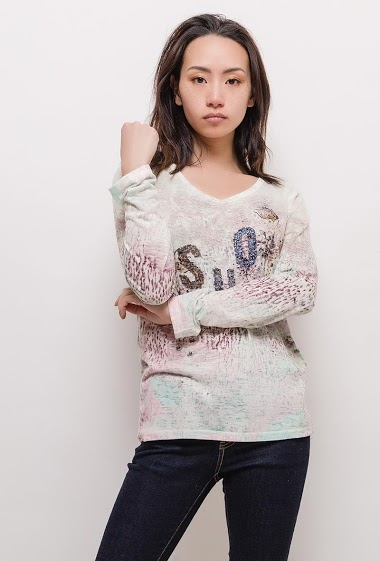 Long sleeve t-shirt. The model measures 170cm and wears M. Length:65cm