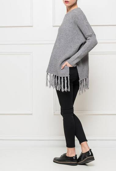 Knit sweater with fringed border, casual fit