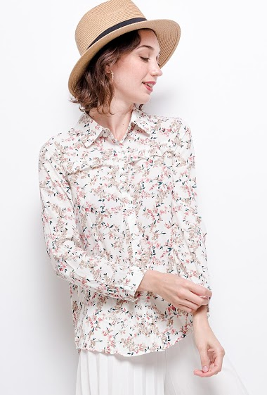 Shirt with ruffles. The model measures 177 cm