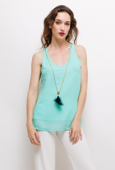 The model measures 177cm and wears S/M. Length:65cm