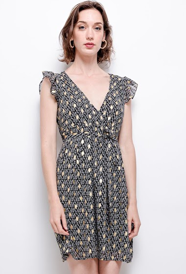 Dress with gold pattern. The model measures 177 cm