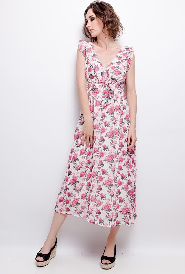 Dress with printed flowers, ruffles. The model measures 177 cm