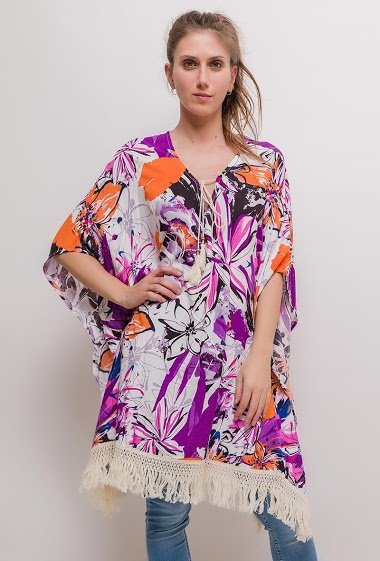 Patterned tunic, tassels, side splits. The model measures 170cm and wears S/M. Length:90cm