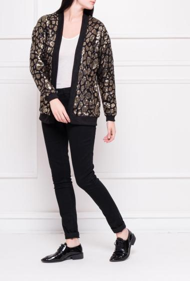 Open jacket in sequins, border in rib
