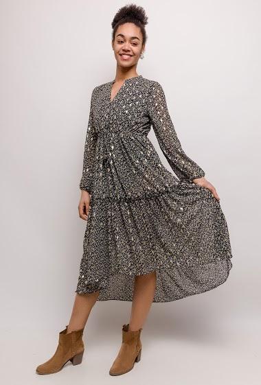 Midi dress with estampado dorado. The model measures 175cm and wears S. Length:124cm