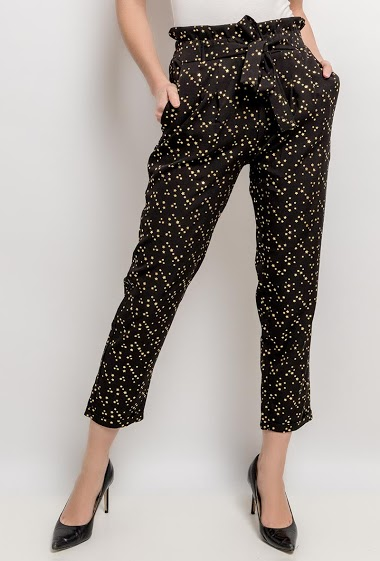 Pants with printed gold stars. The model measures 177cm and wears S