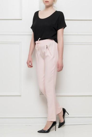 Pantalon à taille élastique, poches zippées décoratives