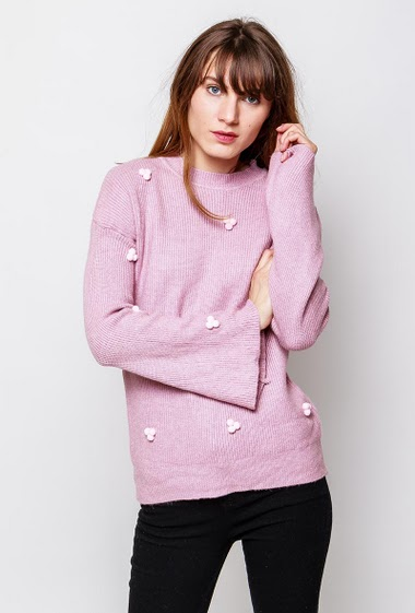 Soft ribbed sweater, fancy pompons, flared long sleeves. The model measures 178cm, one size corresponds to 38-40