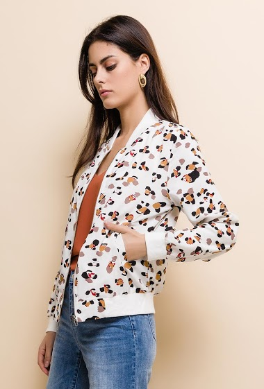 Light bomber, tropical print. The model measures 176cm and wears S. Length:60cm