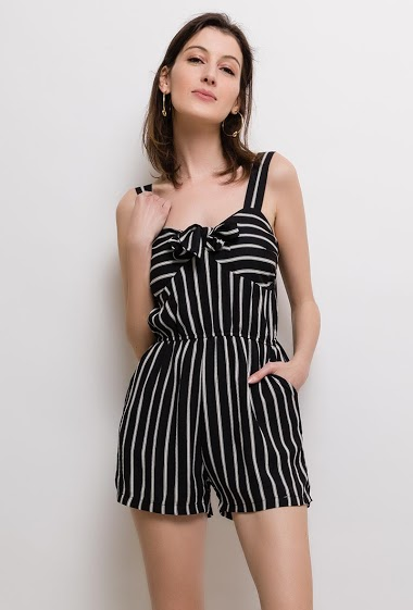 Strappy playsuit, knot front. The model measures 178cm and wears S. Length:80cm
