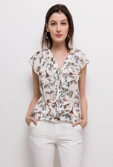 Blouse with animal print. The model measures 178cm and wears S. Length:55cm