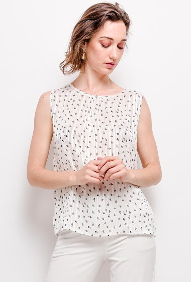 Printed sleeveless top. The model measures 177cm and wears S. Length: 62cm