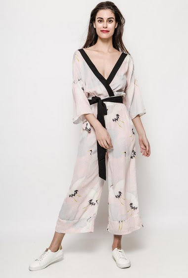 Wrap jumpsuit with printed birds, constrasting border. The model measures 176cm and wears S. Length:115m