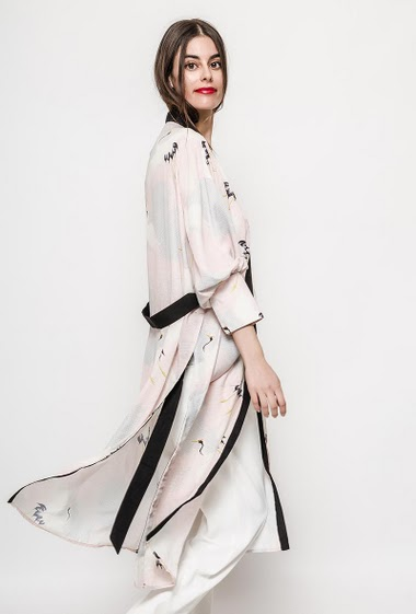 Veste fluide imprimée avec fentes latérales, poches. La mannequin mesure 176cm et porte du S. Longueur:115cm