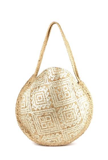Grand sac rond, en toile de jute dorure ethnique double face, porté épaule.