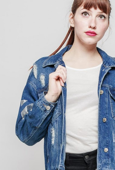 Ripped denim jacket, no stretch, printed back. The mannequin measures 174 cm and wears S/M