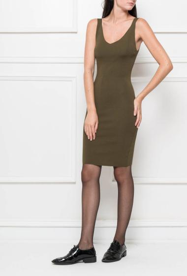 Sleeveless dress in knit with scoop back, slit on the back